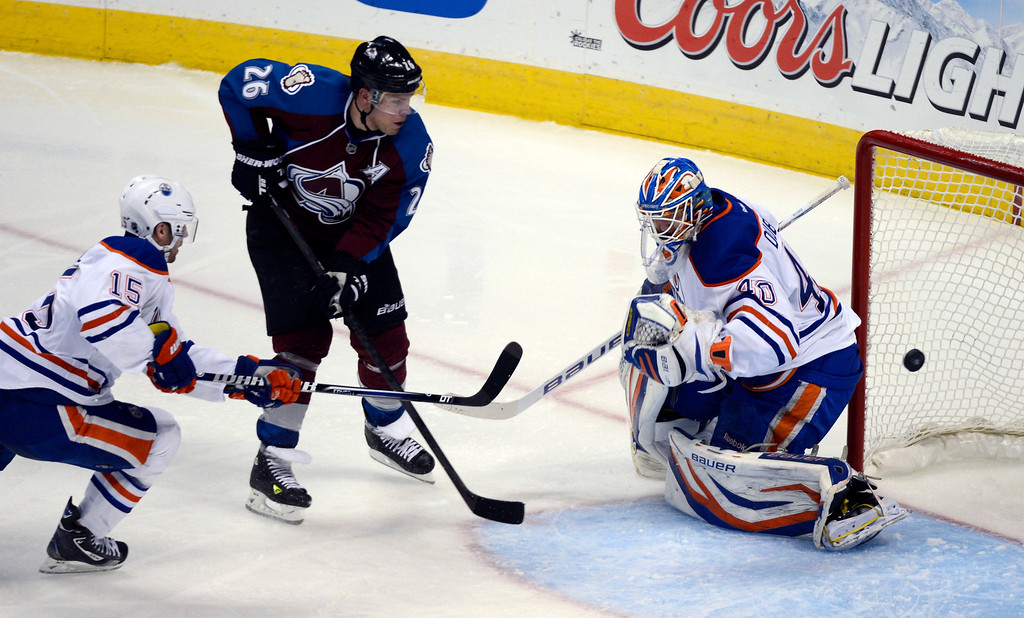. Paul Stastny (26) of the Colorado Avalanche takes a shot and just goes wide past Devan Dubnyk (40) of the Edmonton Oilers during the second period March 12, 2013 at Pepsi Center. (Photo By John Leyba/The Denver Post)
