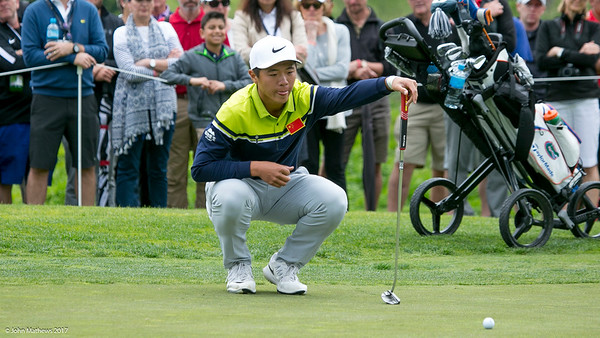 Andy Zhang from China lining up a putt on the 6th hole on the final Day of the Asia-Pacific Amateur Championship tournament 2017 held at Royal Wellington Golf Club, in Heretaunga, Upper Hutt, New Zealand from 26 - 29 October 2017. Copyright John Mathews 2017.   www.megasportmedia.co.nz