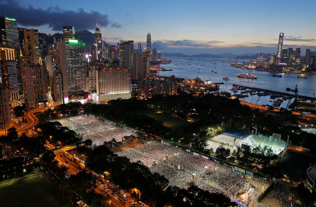 . Tens of thousands of people attend a candlelight vigil at Victoria Park in Hong Kong Wednesday, June 4, 2014, to mark the 25th anniversary of the June 4th Chinese military crackdown on the pro-democracy movement in Beijing. (AP Photo/Vincent Yu)