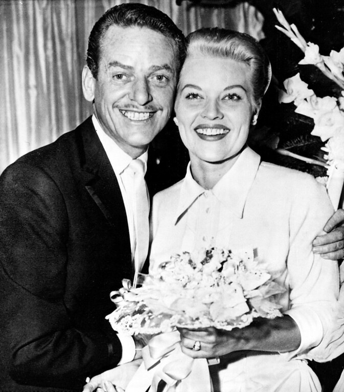 . Singer Patti Page, 29, and choreographer Charles O\'Curran, 42, pose after  their marriage at a friend\'s home in Las Vegas, Nev., Dec. 28, 1956.  (AP Photo)