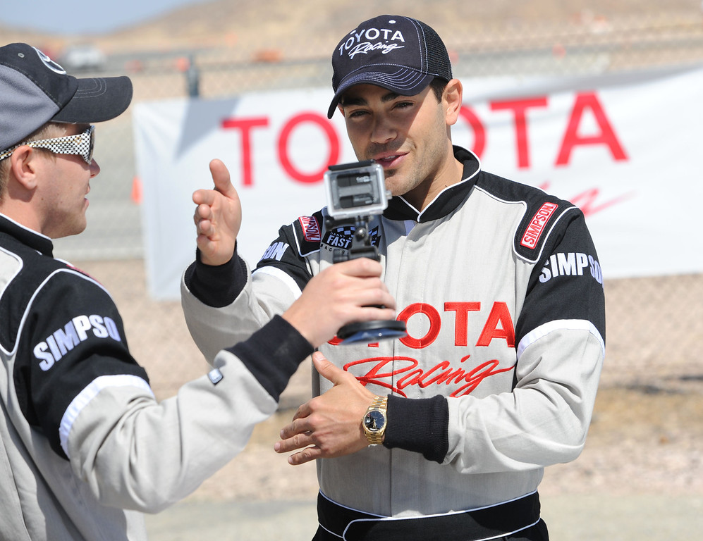 . Rosamond, Calif., -- 03-23-13-  Toyota Pro/ Celebrity Race participant actor Jesse Metcalfe, describes his race in the camera of actor Brett Davern, during a practice session at Willow Springs Raceway. The Toyota Pro/Celebrity Race helps raise money on behalf of Racing for Kids, a fundraising program benefiting Miller Children�s Hospital in Long Beach and Children�s Hospital of Orange County. On behalf of the race and its participants, Toyota has donated more than $2 million to various children�s hospitals since 1991.  Stephen Carr/  Los Angeles Newspaper Group