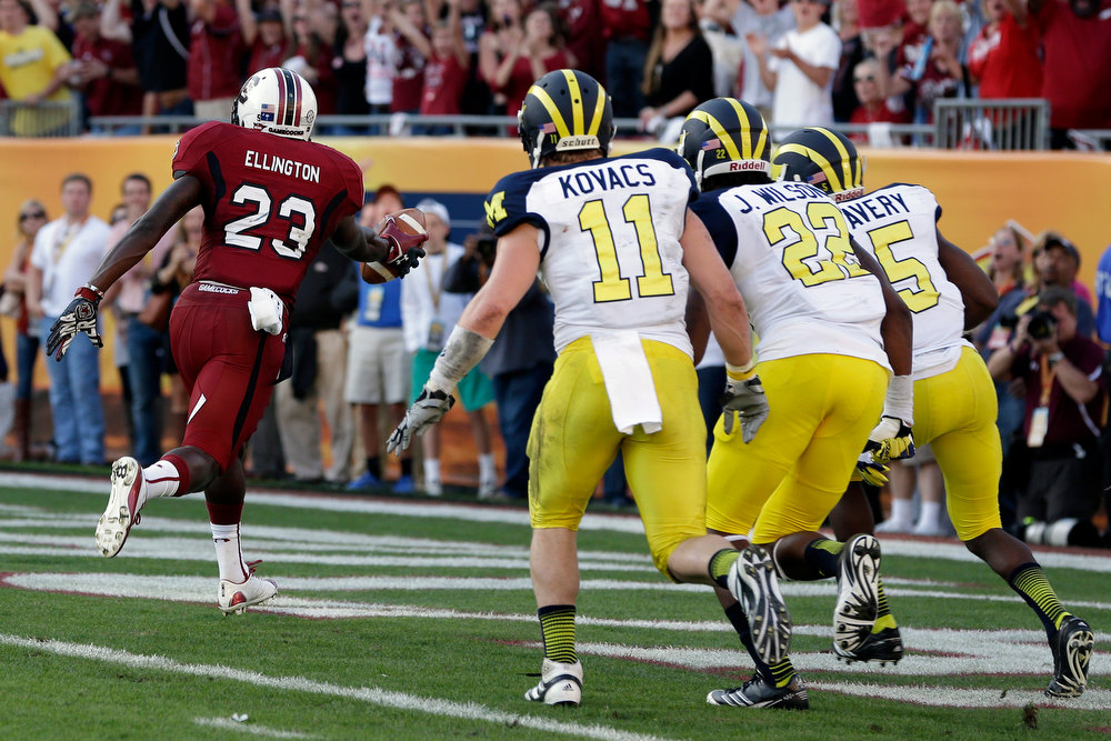 . South Carolina wide receiver Bruce Ellington (23) scores past Michigan safety Jordan Kovacs (11), safety Jarrod Wilson (22), and cornerback Courtney Avery (5) during the second half of the Outback Bowl NCAA college football game, Tuesday, Jan. 1, 2013, in Tampa, Fla. South Carolina won 33-28. (AP Photo/Chris O\'Meara)