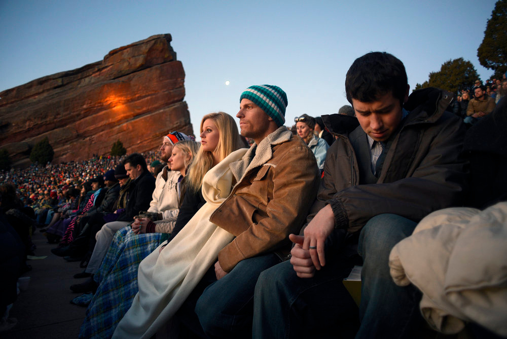 . Alex Johns, of Littleton, right, prays during the service.  Thousands of people turned out for the sixty sixth annual Easter sunrise service at Red Rocks Amphitheatre in Golden on March 31st, 2013.The sun rose at 6:45 am under cloudless skies and this year\'s service was pleasant with warmer temperatures than in previous years.  The service, sponsored by the Colorado Council of Churches, was led by Reverend Dr. Jim Ryan and presided over by Reverend Dr. Janet Forbes.  (Photo By Helen H. Richardson/ The Denver Post)