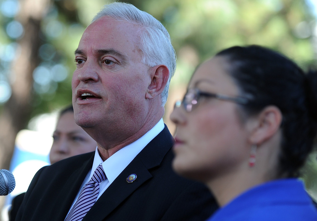 . City of Downey mayor , DN. Mario A. Guerra, left, with assembly member Cristina Garcia (D-Bell Gardens) speaks during a press conference calling for Senator Ron Calderon to resign his position in the California State Senate in front of the Bell Gardens City Hall in Bell Gardens , Calif., on Wednesday, Nov. 13, 2013.   (Keith Birmingham Pasadena Star-News)