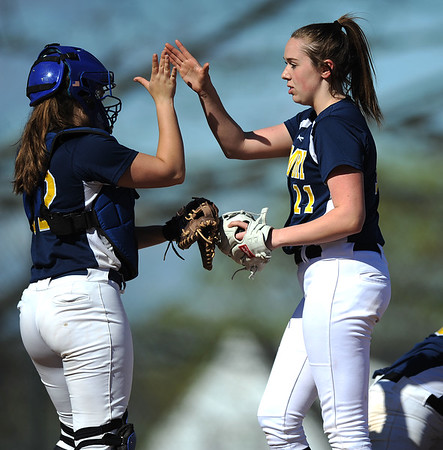 4/24/2019 Mike Orazzi | Staff Simsbury's Jordan Aeschlimann (12) and Brooke Witkin (11) during Wednesday's softball with Bristol Central in Bristol.