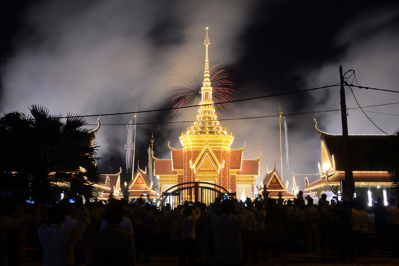 . Cambodian onlookers watch as smoke rises from the crematorium to mark the beginning of the cremation where a coffin bearing the remains of Cambodia\'s late King Norodom Sihanouk is placed, near the Royal Palace in Phnom Penh on February 4, 2013. Thousands of mourners massed in the Cambodian capital as the kingdom cremated its revered former King Norodom Sihanouk, who steered his country through six turbulent decades. AFP PHOTO/ TANG CHHIN SOTHY/AFP/Getty Images