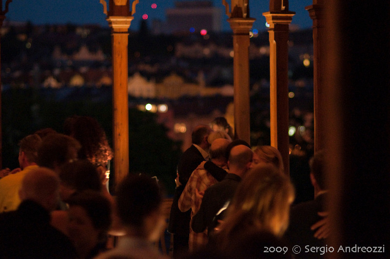 Gold Milonga: tango dancers, in the background, view of Prague