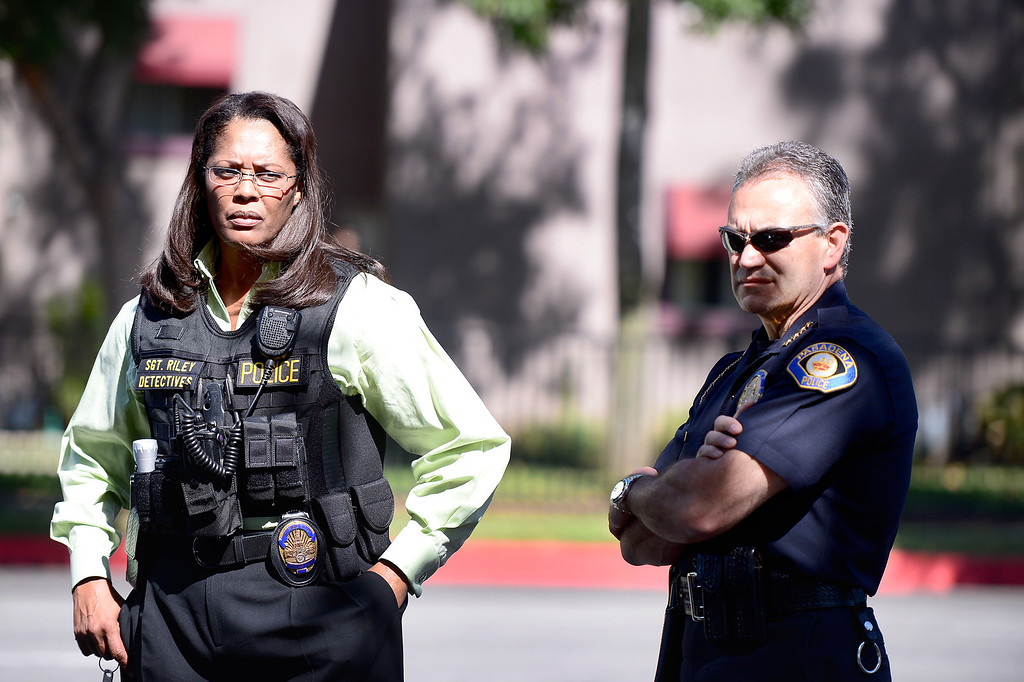 . Pasadena Police Chief Phillip Sanchez, right, and Detective Sgt. Tory Riley standby as Pasadena Police investigate an officer involved shooting at Kings Village in Pasadena Friday, October 11, 2013. (Photo by Sarah Reingewirtz/Pasadena-Star News)