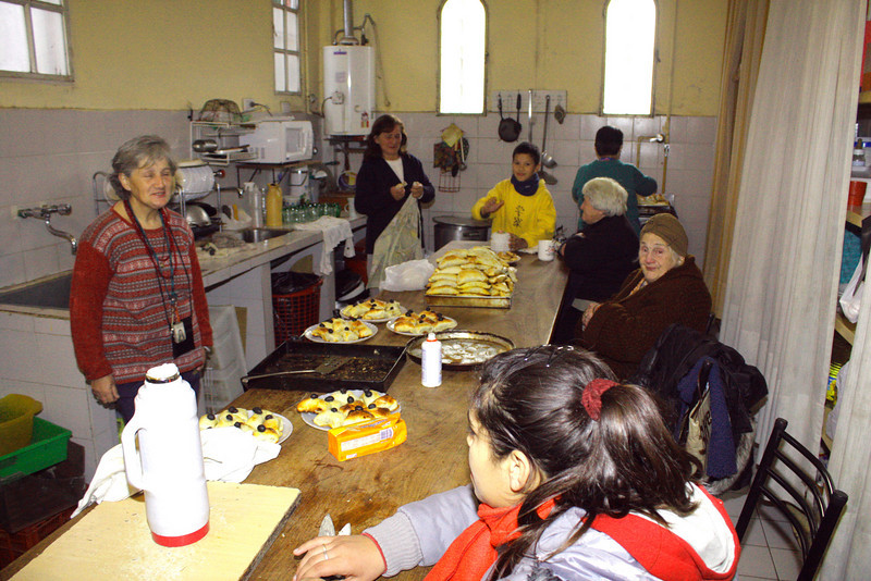 Parishioners preparing food for the reception.