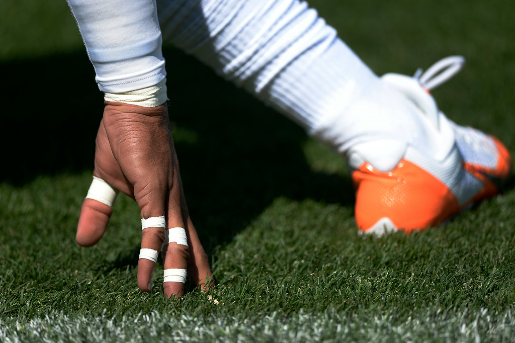 . Denver Broncos defensive back Jordan Sullen (42) is ready with taped finger as he stretches during day two of the Denver Broncos 2014 training camp July 25, 2014 at Dove Valley. (Photo by John Leyba/The Denver Post)