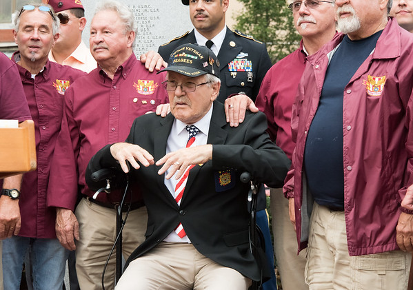 09/11/18 Wesley Bunnell | Staff New Britain unveiled its newest monument in Central Park which is dedicated to the War on Terror following the 9/11 attacks. Vietnam Veteran Robert Nowik, middle, is surrounded fellow veterans.