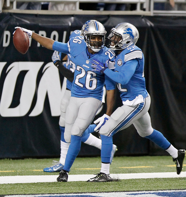 . Detroit Lions strong safety Don Carey (26) is congratulated by strong safety Isa Abdul-Quddus after his 40-yard fumble recovery for a touchdown during the first half of an NFL football game against the Green Bay Packers in Detroit, Sunday, Sept. 21, 2014. (AP Photo/Duane Burleson)