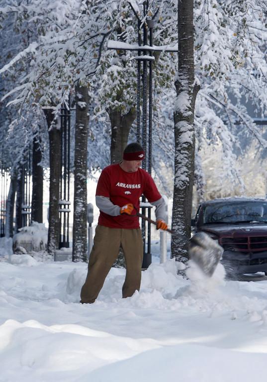 . Arkansas Repertory Theater employee Jeff Roper shovels the sidewalk in front of the theater in downtown Little Rock, Ark., Wednesday, Dec. 26, 2012. (AP Photo/Arkansas Democrat-Gazette, Jeff MItchell)