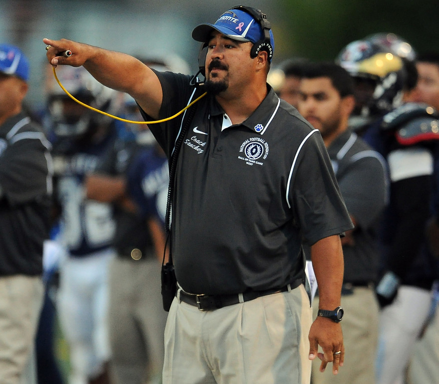 . West head coach Joel Sanchez in the first half of the annual East vs. West San Gabriel Valley Hall of Fame all-star football game at West Covina High School on Friday, May 17, 2013 in West Covina, Calif. 