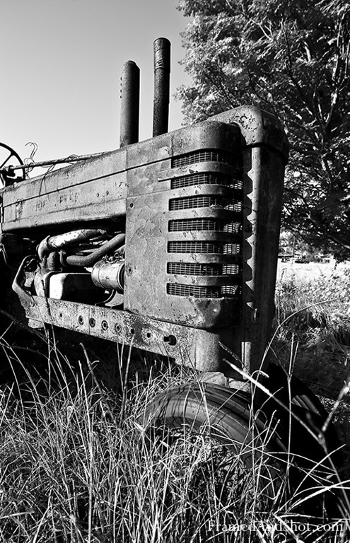 "Tractor A change from the old cars, here is an old tractor.  The first engine-powered farm tractors used steam and were introduced in 1868. Henry Ford produced his first experimental gasoline powered tractor in 1907. it was referred to as an ""automobile plow"" and the name tractor was not used."
