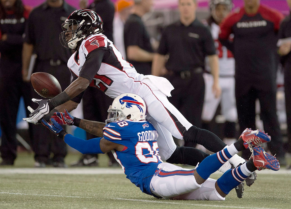 . Atlanta Falcons cornerback Desomnd Trufant, top,  breaks up a pass intended for Buffalo Bills wide receiver Marquise Goodwin during first half NFL football action in Toronto on Sunday Dec. 1, 2013. (AP Photo/The Canadian Press, Frank Gunn)