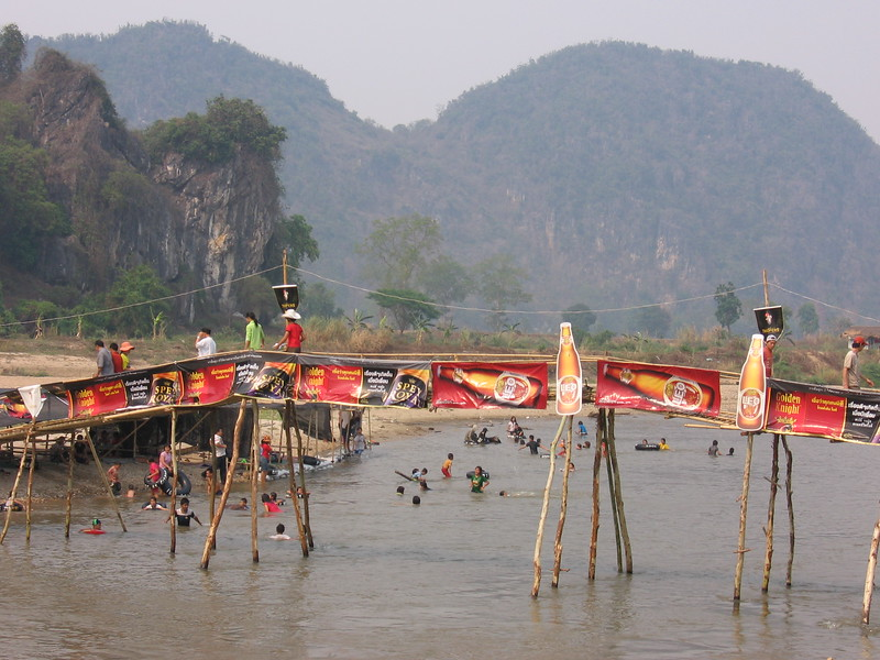 The Mae Kok River at Chiang Rai Beach, where people celebrate by renting tubes and taking a dip in the river.