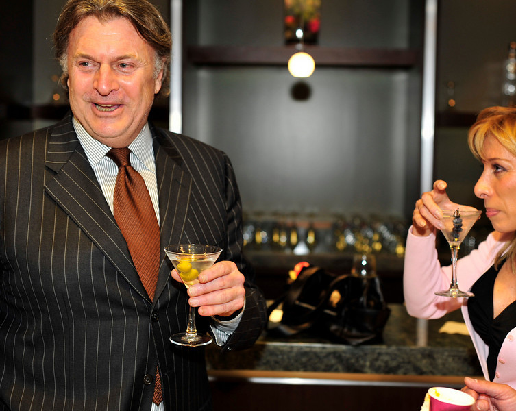 """""""Luxury Marketing Council"""" and Greg Furman are in Las Vegas to open a branch of their famous luxury branding think-tank with a kick-off salon party in these photos on the 16th floor of the World Market Center in Las Vegas with iS Vodka generously supplying their award winning vodka administered by iS Angel Robin and her iS sculpture luge for tasting the 7 times distilled Icelandic vodka in its purest form. About LMC - Since 1994, The Luxury Marketing Council has set out to be the gold standard for the intelligent exploration of the best marketing practices and trends in the luxury world.  The Luxury Marketing Council is a by-invitation only organization of over 2000 members-all CEOs and CMOs in sixteen cities worldwide, representing 700 luxury brands."""