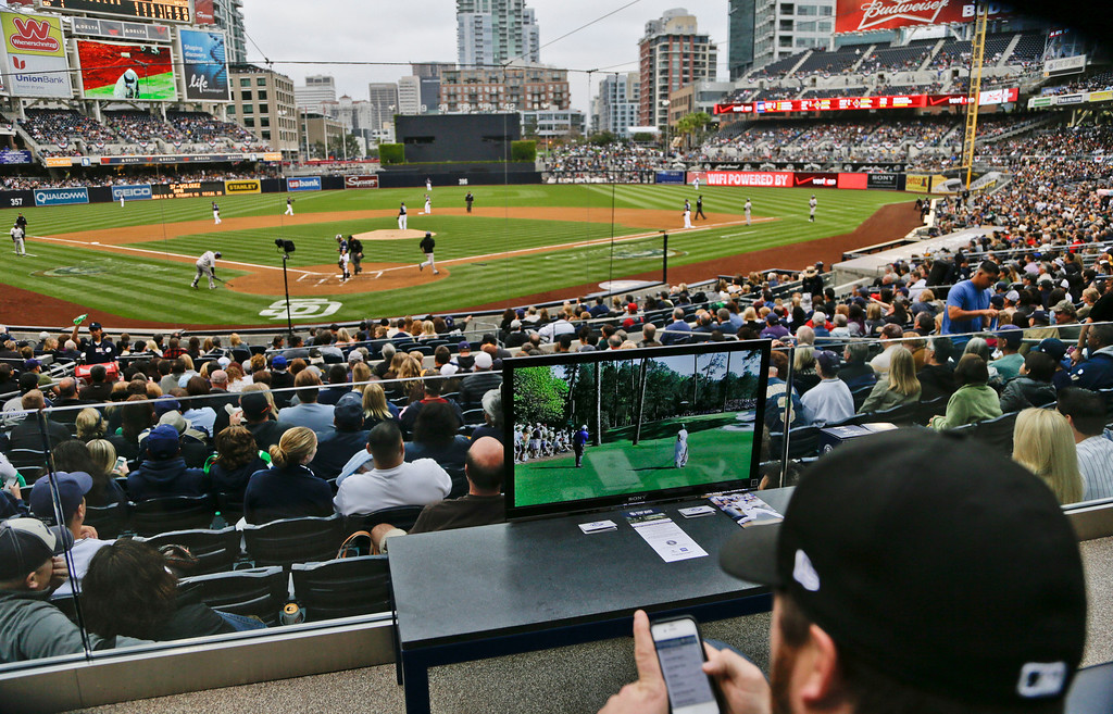 ". Patrons enjoying the new ""living room box seats\"" in Petco Park tune in the highlights from the Masters Golf tournament during a baseball game between the San Diego Padres and Colorado Rockies, Saturday April 13, 2013, in San Diego. (AP photo/Lenny Ignelzi)"