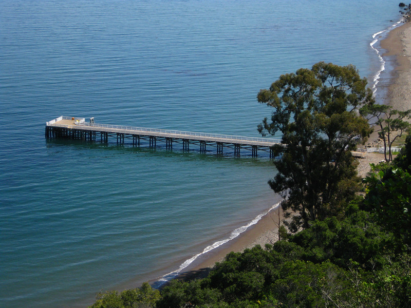 View on the Prisoners Harbor pier and the beach with eucalyptus trees.