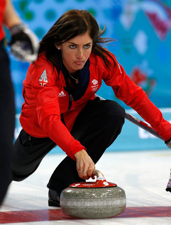 . Great Britain\'s skip Eve Muirhead delivers the rock during women\'s curling competition against the United States at the 2014 Winter Olympics, Tuesday, Feb. 11, 2014, in Sochi, Russia. (AP Photo/Robert F. Bukaty)