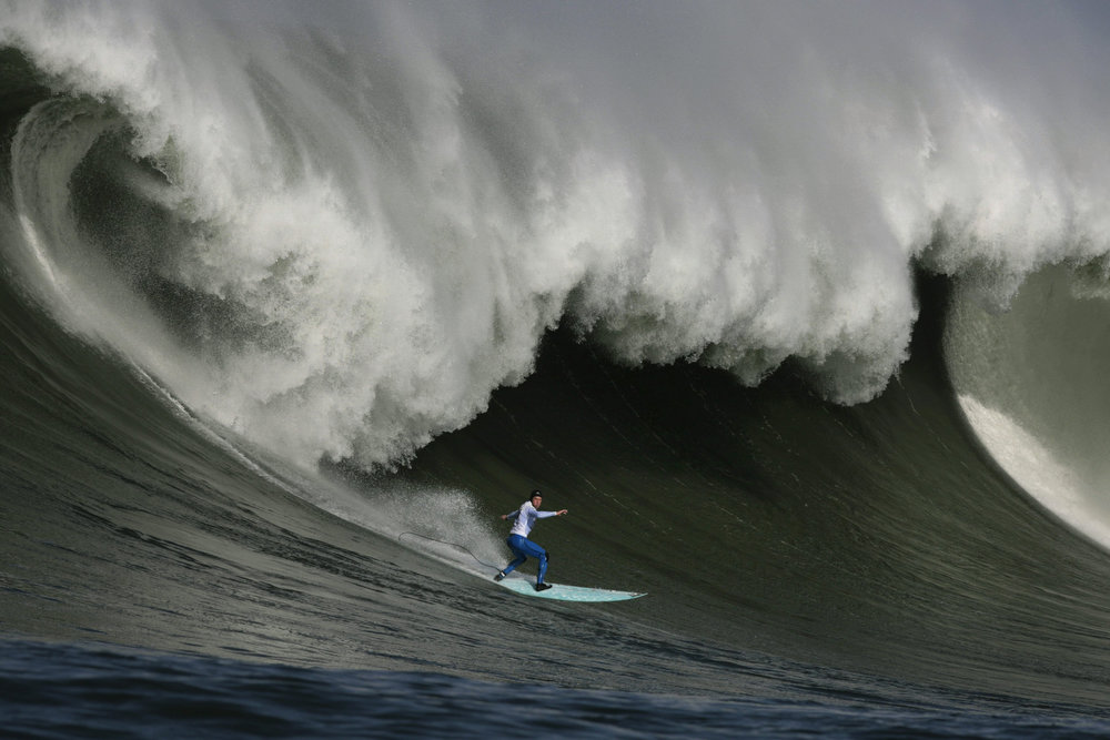 Description of . Shane Desmond competes in the 2010 Maverick's Big Wave Surf Contest at the Mavericks surf break off Half Moon Bay on Saturday, Feb. 13, 2010.  Surfers from around the world, including three-time winner Darryl