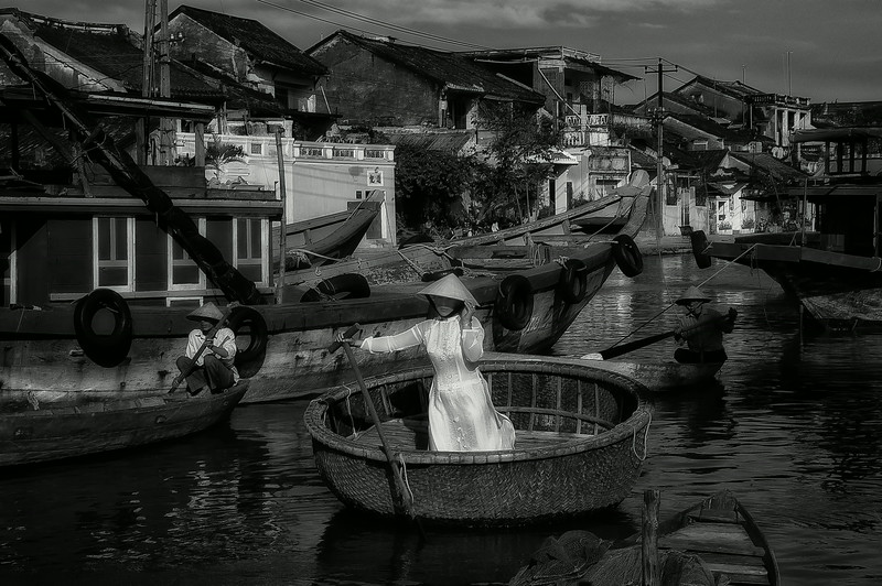 Woman rowing on a traditional sampan,   Hoi An, Vietnam, 2008.