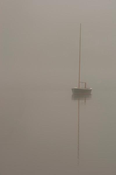 Boat in morning fog
