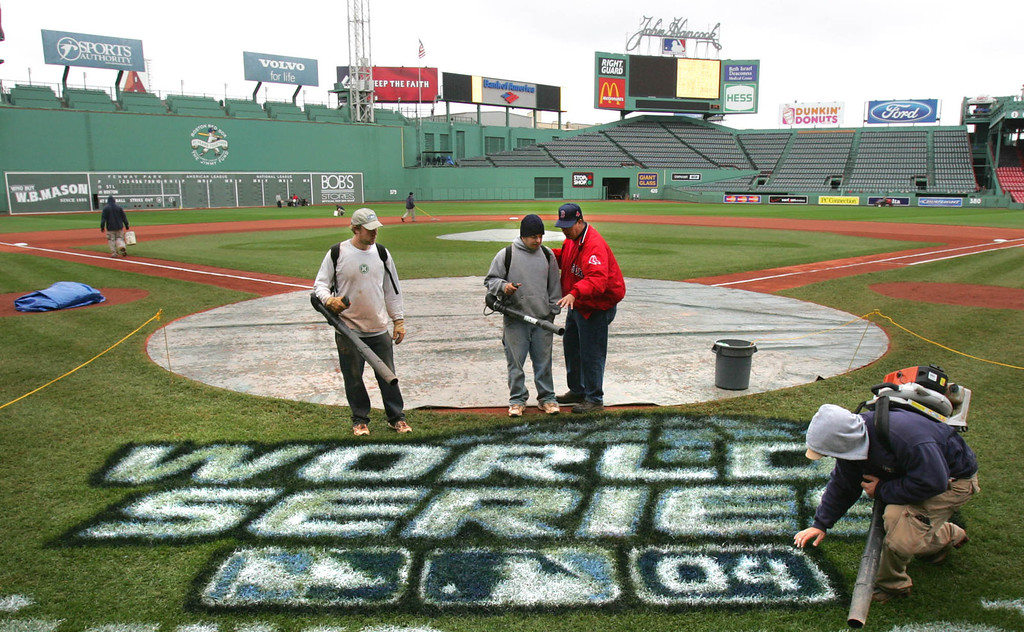 . The Fenway Park grounds crew checks to see if the paint is dry on the World Series logo on the field in Boston, Friday Oct. 22, 2004.  The Boston Red Sox will play the St. Louis Cardinals in the World Series, starting on Saturday at Fenway Park. (AP Photo/Charles Krupa)