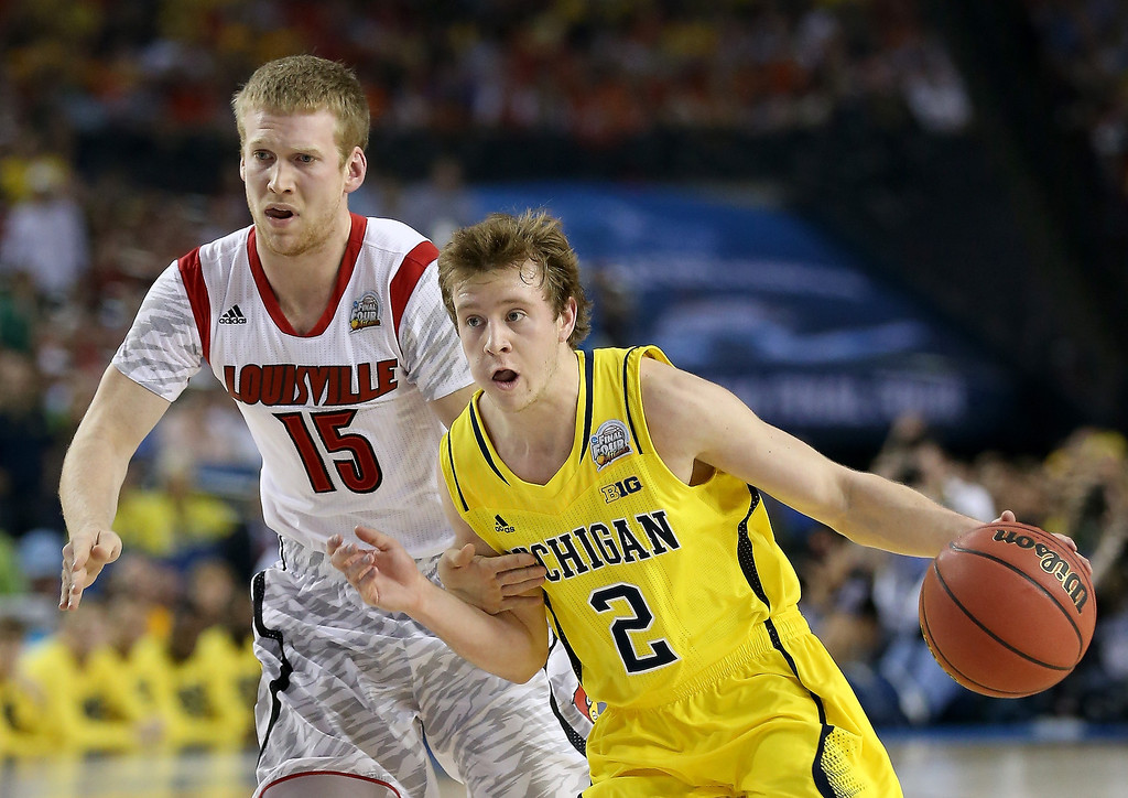 . Spike Albrecht #2 of the Michigan Wolverines drives in the first half against Tim Henderson #15 of the Louisville Cardinals during the 2013 NCAA Men\'s Final Four Championship at the Georgia Dome on April 8, 2013 in Atlanta, Georgia.  (Photo by Streeter Lecka/Getty Images)