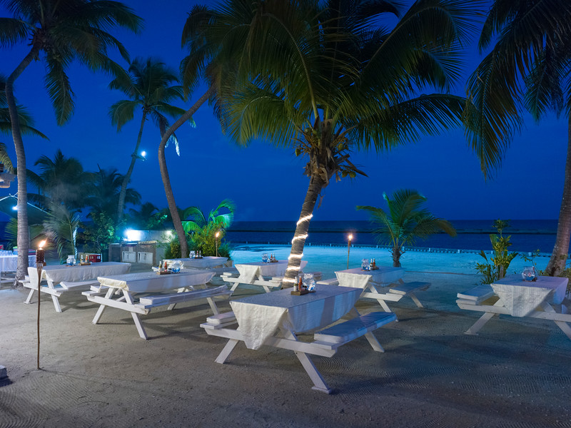 Picnic benches on the beach, Caribbean Sea, Turneffe Island, Belize