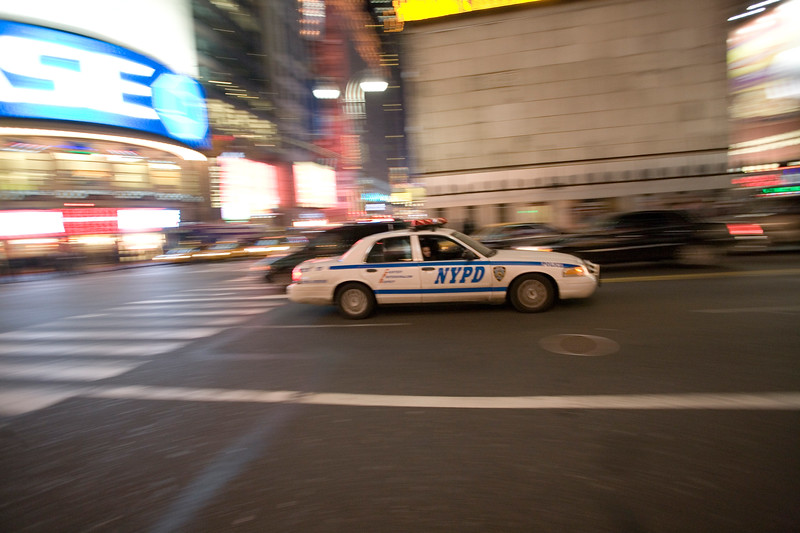 Panning shot of a NYPD car on Times Square, NY, USA.