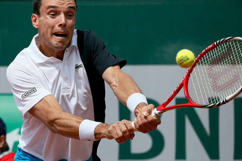 . Spain\'s Roberto Bautista Agut hits a shot to France\'s Jeremy Chardy during their French Tennis Open match at the Roland Garros stadium in Paris, on May 29,  2013.  KENZO TRIBOUILLARD/AFP/Getty Images