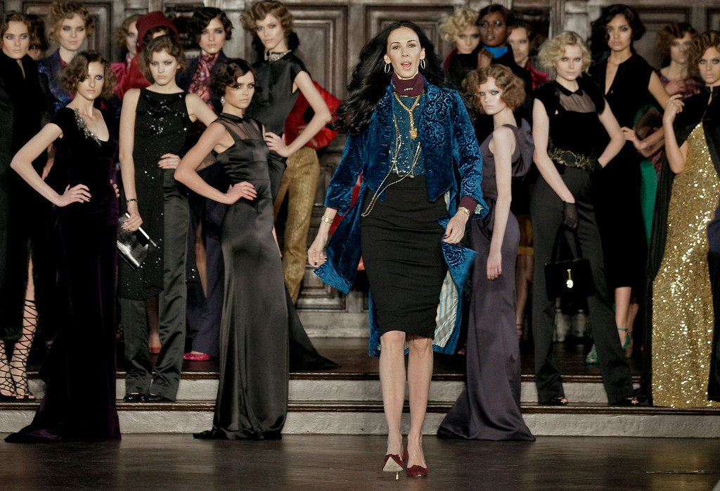 . FILE - This Feb. 16, 2012 file photo shows designer L�Wren Scott, center, after her Fall 2012 collection was modeled during Fashion Week, in New York. Scott was found dead Monday, March 17, 2014, in Manhattan of a possible suicide. (AP Photo/Richard Drew, File)