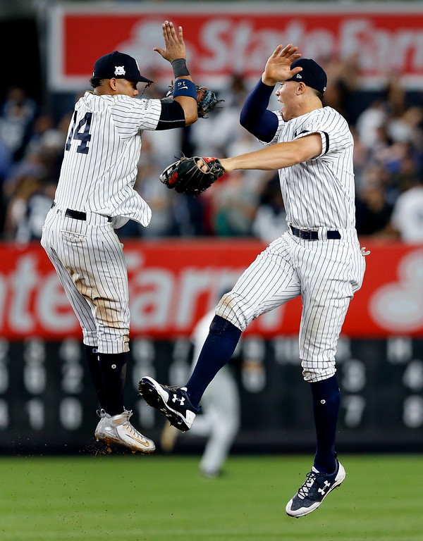 . New York Yankees second baseman Starlin Castro (14) celebrates with Aaron Judge after the Yankees beat the Cleveland Indians in Game 4 of baseball\'s American League Division Series, Monday, Oct. 9, 2017, in New York. The Yankees won 7-3.(AP Photo/Kathy Willens)