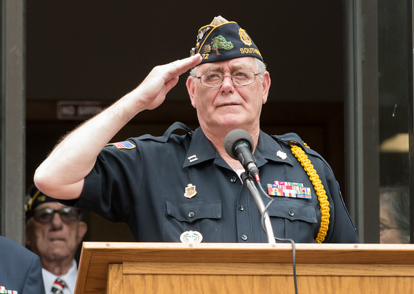 05/28/18 Wesley Bunnell   Staff A packed parade route greeted marchers in the 2018 Memorial Day Parade in Southington on Monday morning. Past Commander of American Legion Post 72 Steve McCarty salutes as TAPS is played.