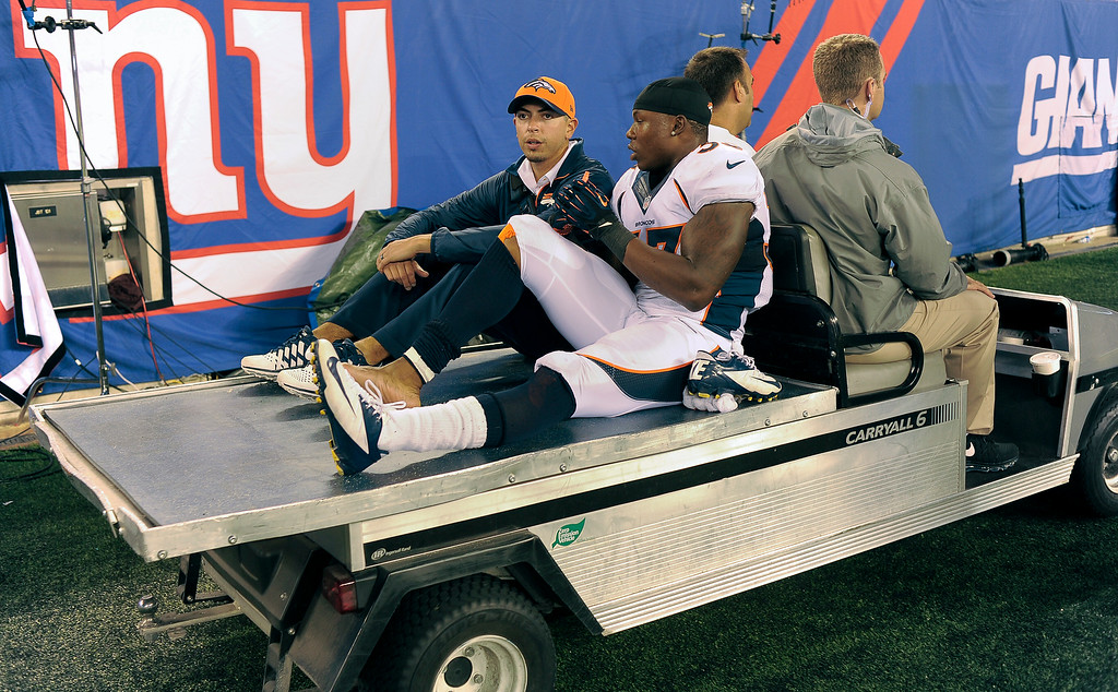 . Denver Broncos strong safety Duke Ihenacho (33) is carted off the field during the fourth quarter September 15, 2013 MetLife Stadium. (Photo by John Leyba/The Denver Post)