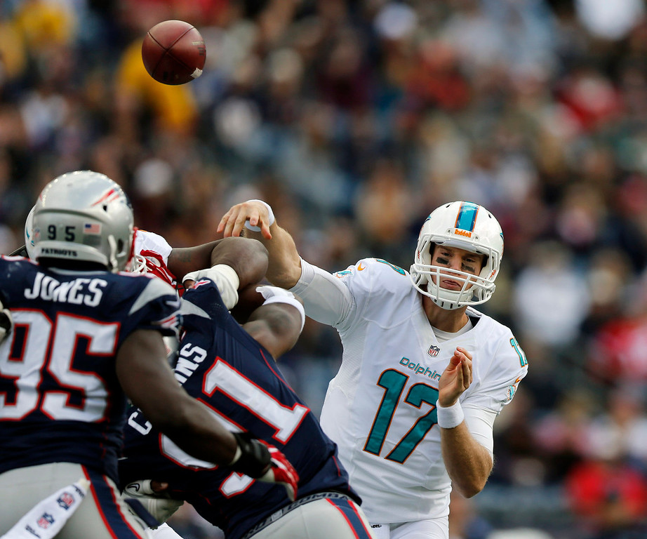 . Miami Dolphins quarterback Ryan Tannehill (17) passes against the New England Patriots in the first quarter of an NFL football game on Sunday, Oct. 27, 2013, in Foxborough, Mass. (AP Photo/Michael Dwyer)