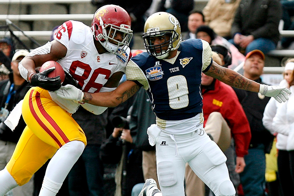 Description of . Southern California tight end Xavier Grimble (86) catches a pass while defended by Georgia Tech defensive back Louis Young during the Sun Bowl NCAA college football game, Monday, Dec. 31, 2012, in El Paso, Texas. (AP Photo/Mark Lambie)
