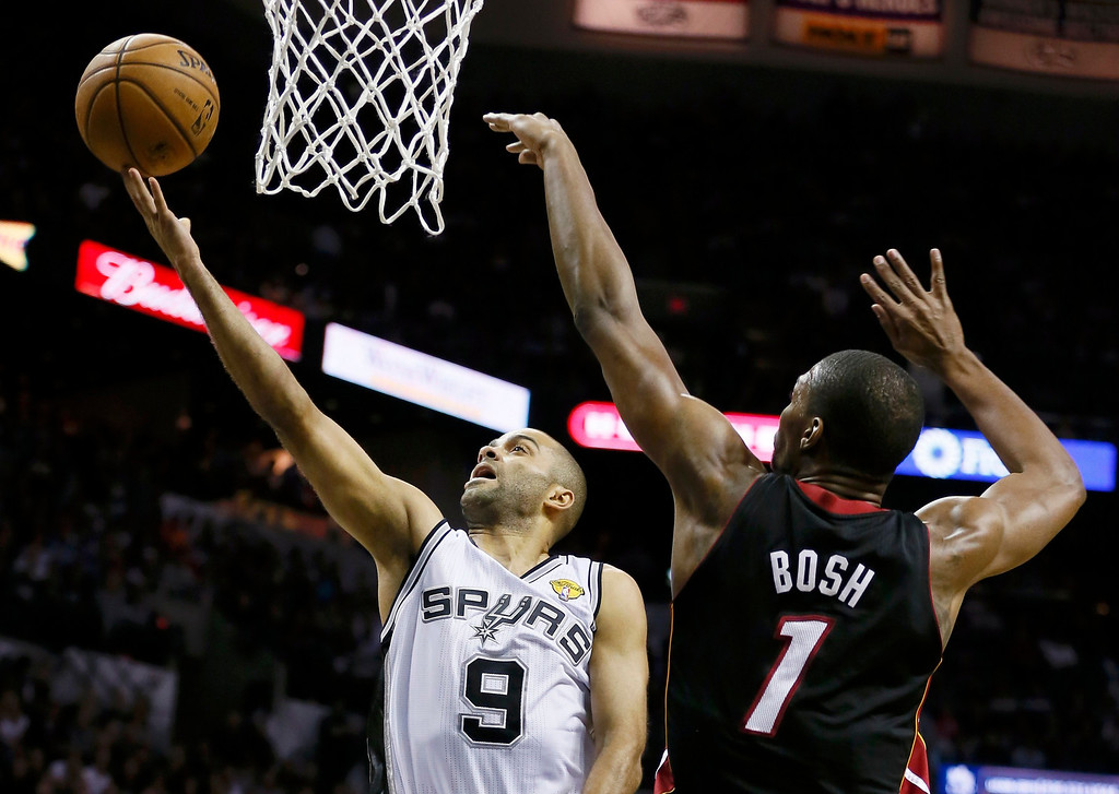 . San Antonio Spurs\' Tony Parker (L) drives to the net on Miami Heat\'s Chris Bosh during the first quarter in Game 4 of their NBA Finals basketball series in San Antonio, Texas June 13, 2013.  REUTERS/Lucy Nicholson