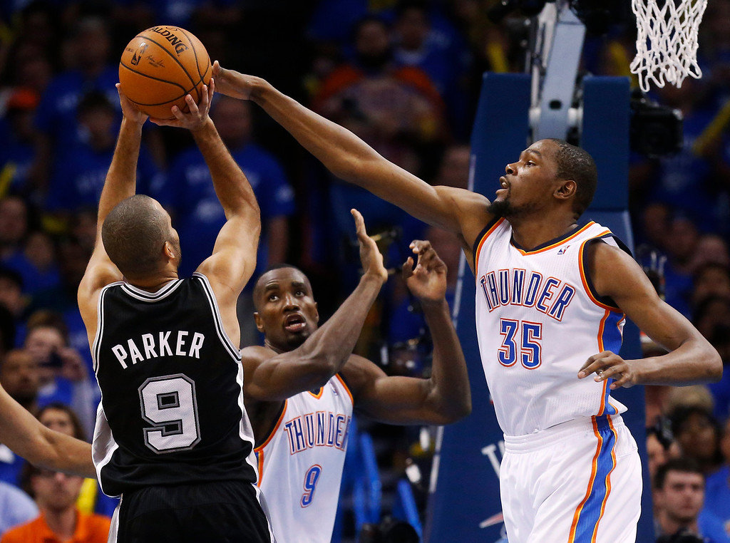 . Oklahoma City Thunder forward Kevin Durant (35) blocks a shot by San Antonio Spurs guard Tony Parker (9), of France, in the second quarter of Game 3 of an NBA basketball playoff series in the Western Conference finals, Sunday, May 25, 2014, in Oklahoma City. Oklahoma City won 106-97. (AP Photo/Sue Ogrocki)