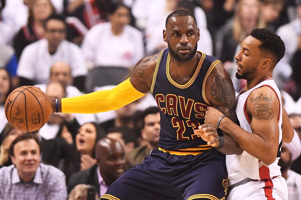 . Cleveland Cavaliers forward LeBron James (23) protects the ball from Toronto Raptors guard Norman Powell (24) during the first half of Game 3 of an NBA basketball second-round playoff series in Toronto on Friday, May 5, 2017. (Frank Gunn/The Canadian Press via AP)