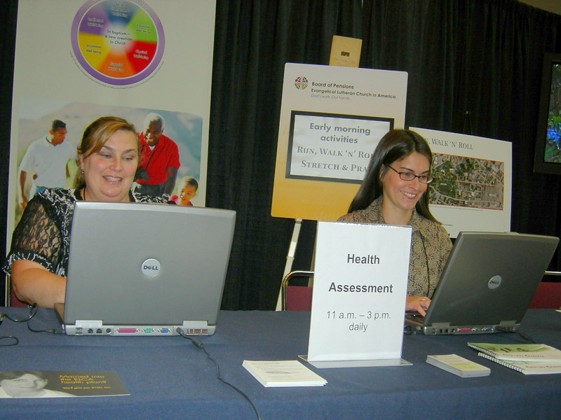 Teresa Gonyer and Connie Clausen of the ELCA Board of Pensions assists plan members in signing-up for the Health Assessment.