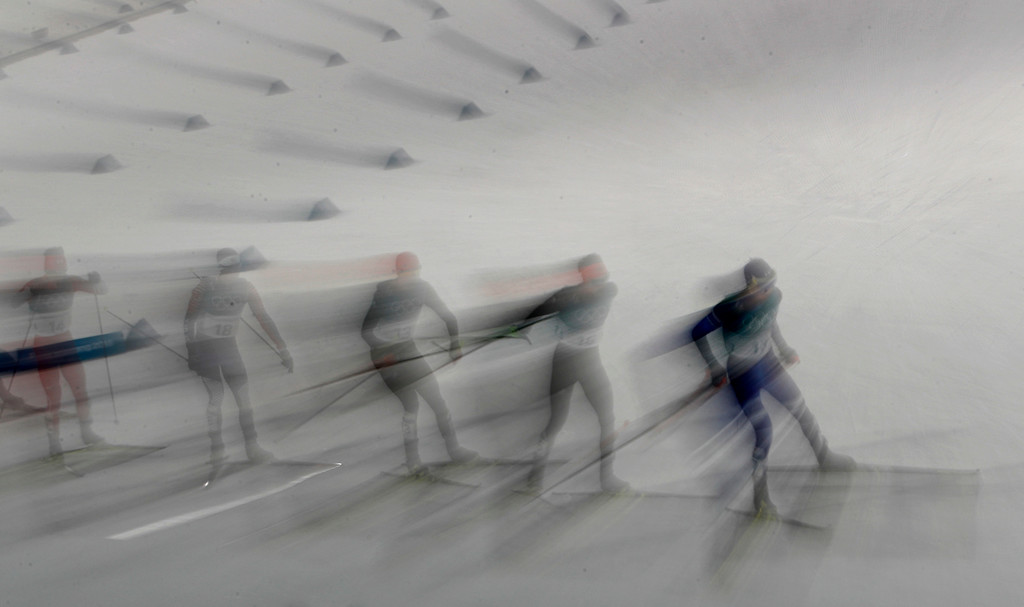 . Athletes compete in the 10km cross-country skiing portion of the nordic combined event at the 2018 Winter Olympics in Pyeongchang, South Korea, Wednesday, Feb. 14, 2018. (AP Photo/Charlie Riedel)