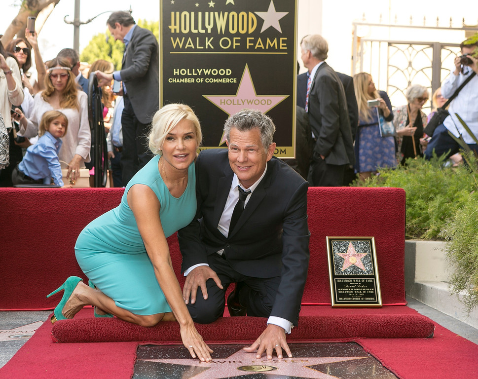 . Canadian songwriter and producer David Foster, with his wife Yolanda Hadid, is honored with a star on the Hollywood Walk of Fame outside the Capitol Records Tower in Los Angeles Friday, May 31, 2013. (AP Photo/Damian Dovarganes)