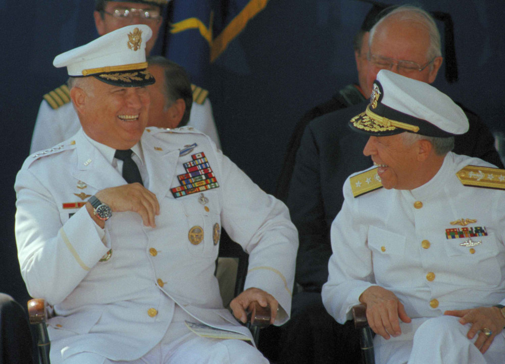 . U.S. Army General H. Norman Schwarzkopf, left, and U.S. Naval Academy superintendent Rear Admiral Virgil L. Hill Jr., share a laugh before Schwarzkopf?s address at the academy?s graduation and commissioning ceremonies in Annapolis,, Wednesday, May 29, 1991. (AP Photo/Edwin Remsberg)