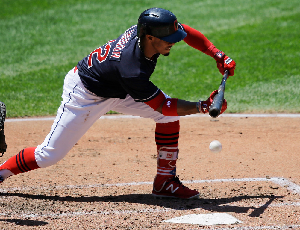 . Cleveland Indians\' Francisco Lindor bunts in the third inning of a baseball game against the Chicago White Sox, Sunday, June 11, 2017, in Cleveland. Lindor was out on batter\'s interference to catcher. (AP Photo/Tony Dejak)