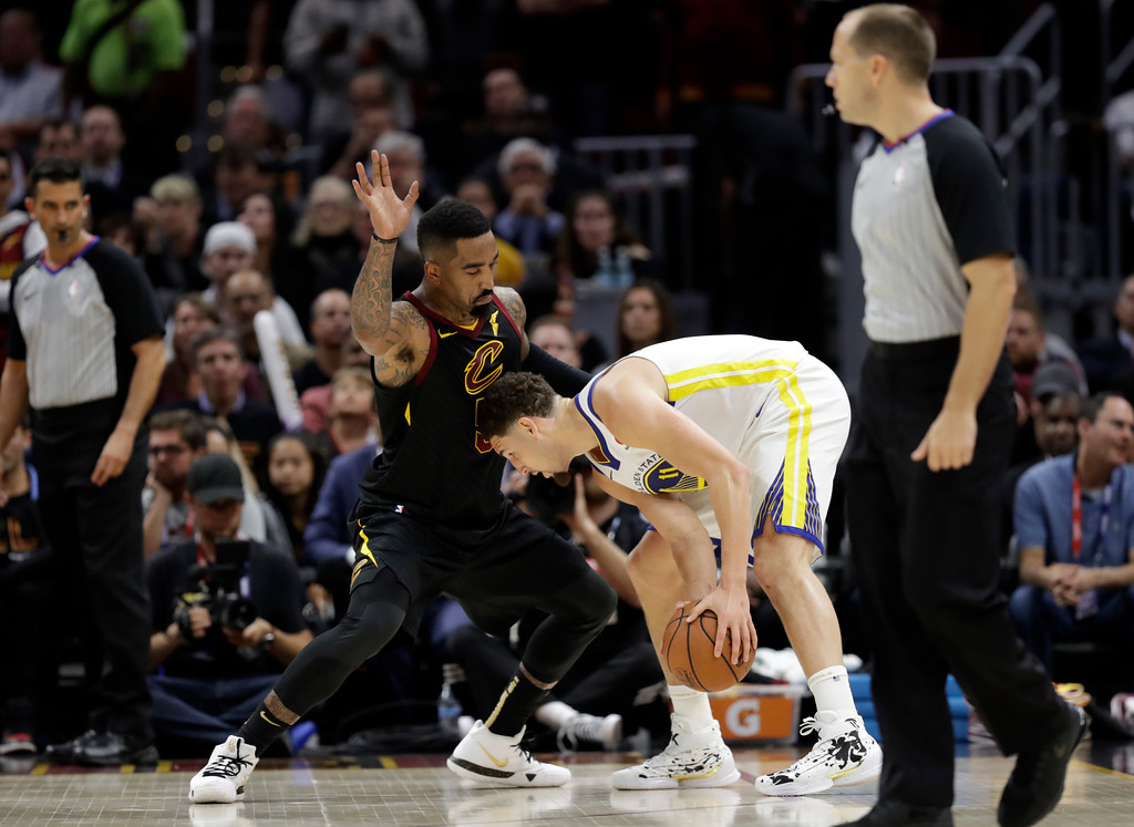 . Cleveland Cavaliers guard JR Smith (5) guards Golden State Warriors guard Klay Thompson (11) during the second half of Game 3 of basketball\'s NBA Finals, Wednesday, June 6, 2018, in Cleveland. (AP Photo/Tony Dejak)