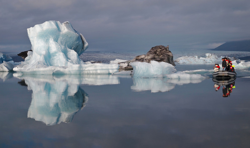 The spectacular Jokulsarlon lagoon on the south east side of Iceland. Naturally created by the glacier meltwater from Vatnajokull, which is Europe's largest glacier. The lagoon is full of floating icebergs such as this which are constantly moving. Extremely dangerous too and quite common for them to topple over. As such nobody is allowed to moor up and walk on them. This place was the setting for the James Bond (Pierce Brosnan) film 'Die Another Day' in 2002. The lagoon was deliberately blocked off from the sea (which it connects) for 6 weeks in February in order to prevent salt water inflow (the lagoon is 50/50 salt/fresh water). The lagoon was then closed off for 2 weeks to allow the saltwater to sink thus leaving the freshwater on top to freeze. Once the lagoon was frozen filming commenced :-)