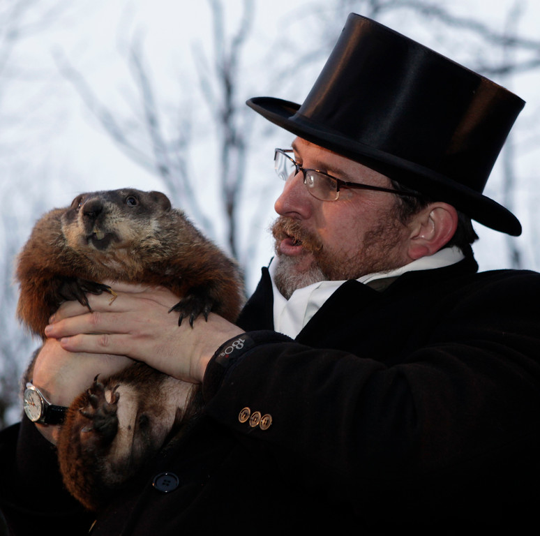 . Ben Hughes, handler of the weather-predicting groundhog Punxsutawney Phil, holds Phil after removing him from his stump at Gobbler\'s Knob on Groundhog Day, Monday, Feb. 2, 2009, in Punxsutawney, Pa. The Groundhog Club said Phil saw his shadow and predicted six more weeks of winter. (AP Photo/Carolyn Kaster)